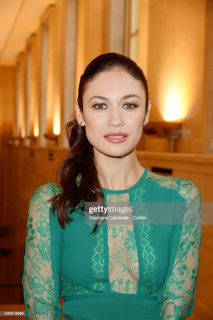 Olga Kurylenko attends the Elie Saab show as part of Paris Fashion Week Haute Couture Spring/Summer 2014 , at Theatre National de Chaillot, in Paris.