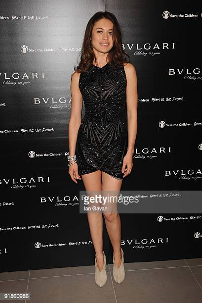 Olga Kurylenko attends the Vogue Bvlgari 125th Anniversary Party supporting Save the Children at the Saatchi Gallery on October 13 2009 in London...