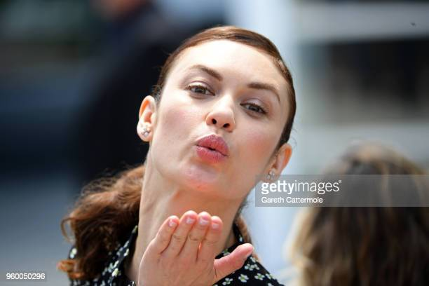 Olga Kurylenko blows a kiss during The Man Who Killed Don Quixote Photocall during the 71st annual Cannes Film Festival at Palais des Festivals on...