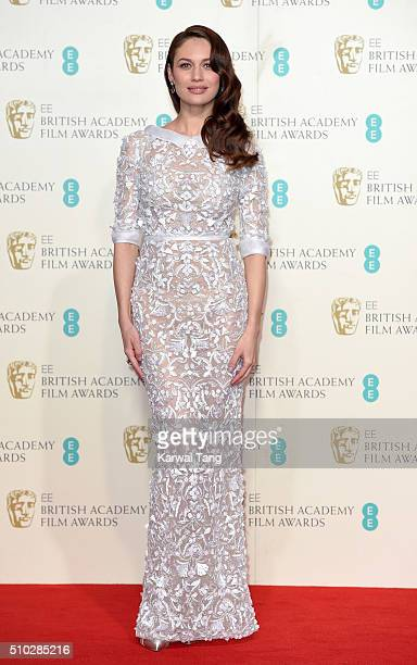 Olga Kurylenko poses in the winners room at the EE British Academy Film Awards at The Royal Opera House on February 14 2016 in London England