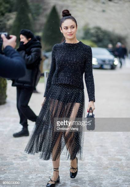 Olga Kurylenko wearing sweater sheer dress flats is seen outside Dior on February 27 2018 in Paris France