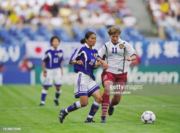 Olga Letyushova, Forward for Russia challenges Homare Sawa, Captain and Midfielder for Japan during their Group C match of the FIFA Women's World Cup...