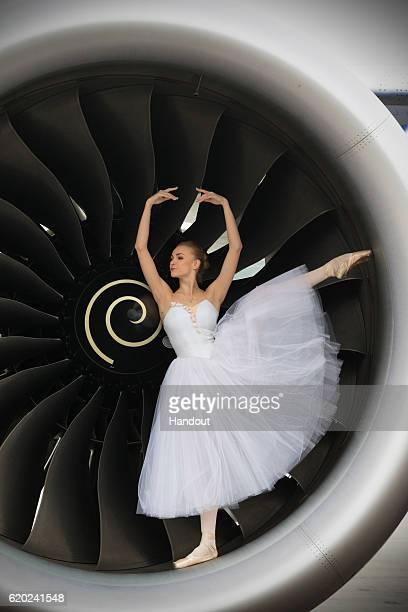 Olga Marchenkova of the Bolshoi Ballet poses on a British Airways Boeing 7879 Dreamliner to mark the launch of British Airways' Dreamliner flights...