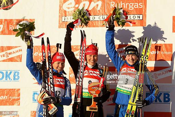 Olga Medvedtseva of Russia, Kati Wilhelm of Germany and Helena Jonsson poses for a picture after he Women mass start of the E.ON Ruhrgas IBU Biathlon...