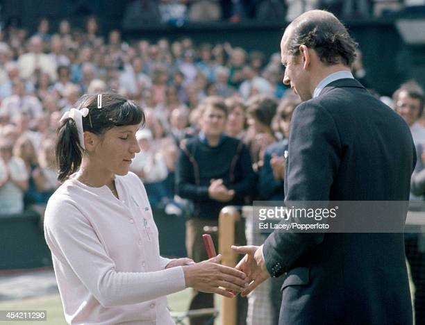 Olga Morozova of the USSR receives her runnerup prize from Prince Edward Duke of Kent after her straight sets defeat by Chris Evert in the Women's...