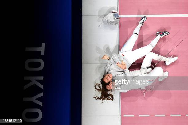 Team ROC celebrate after winning the Women's Sabre Team Fencing Gold Medal Match against Team France on day eight of the Tokyo 2020 Olympic Games at...