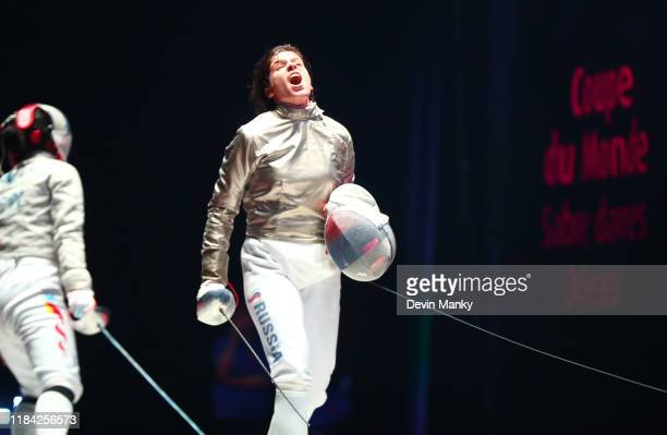 Olga Nikitina of Russia celebrates after defeating Yaqui Shao of China during the semifinal round of competition at the Women's Sabre World Cup on...