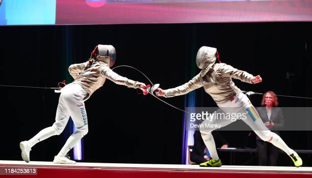 Olga Nikitina of Russia fences Bianca Pascu of Romania during the top 8 round of competition at the Women's Sabre World Cup on November 23 2019 at...