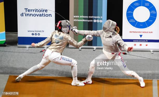 Olga Nikitina of Team Russia fences Sooyeon Choi of Team Korea during the gold medal match of the team competition at the Women's Sabre World Cup on...