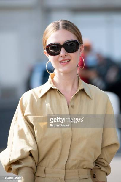 Olga Nikitkuva wears a Celine bag and sunglasses and Massimo Dutti jumpsuit and shoes on June 30 2019 in Paris France