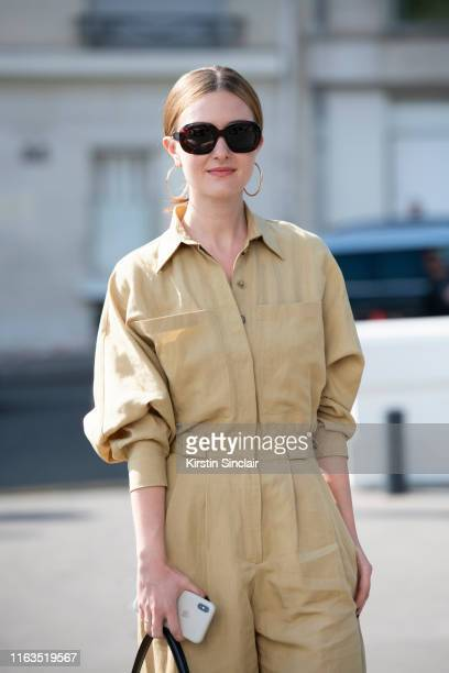 Olga Nikitkuva wears Celine sunglasses and a Massimo Dutti jumpsuit on June 30 2019 in Paris France