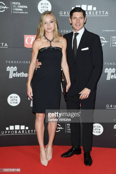 Olga Plachina and Aldo Montano attend the Telethon Gala during the 13th Rome Film Fest at Villa Miani on October 19 2018 in Rome Italy