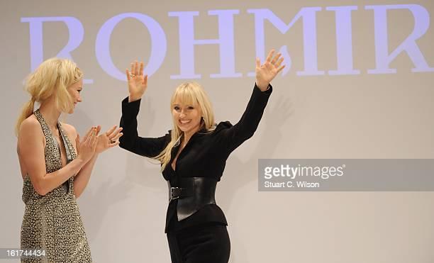 Olga Roh and German model Franziska Knuppe walks the runway at the Rohmir presentation during London Fashion Week Fall/Winter 2013/14 at Freemasons...