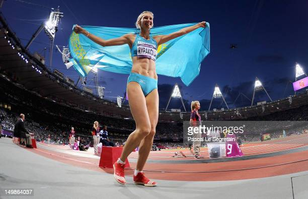 Olga Rypakova of Kazakhstan celebrates winning gold in the Women's Triple Jump on Day 9 of the London 2012 Olympic Games at Olympic Stadium on August...