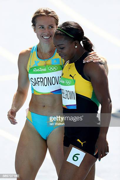 Olga Safronova of Kazakhstan and Veronica CampbellBrown of Jamaica react after round one of the Women's 200m on Day 10 of the Rio 2016 Olympic Games...