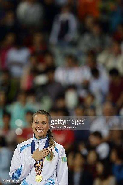 Olga Safronova of Kazakhstan celebrates winning the gold medal in the Women's 200m Final on day twelve of the 2014 Asian Games at Incheon Asiad Main...