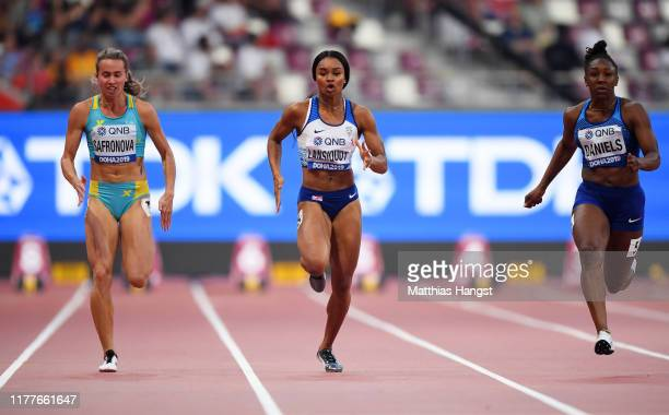 Olga Safronova of Kazakhstan Imani Lansiquot of Great Britain and Teahna Daniels of the United States compete in the Women's 100m heats during day...