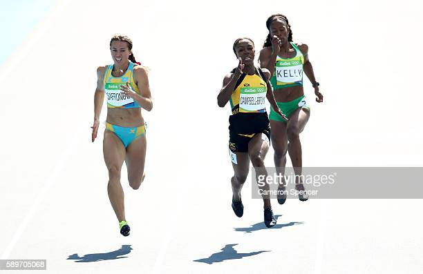 Olga Safronova of Kazakhstan Veronica CampbellBrown of Jamaica and Ashley Kelly of Virgin Islands British compete in round one of the Women's 200m on...