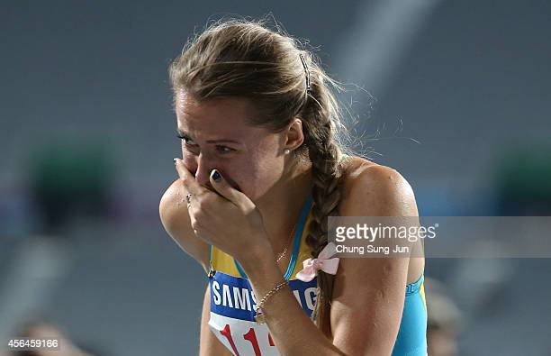 Olga Safronova of Kazakhstan wins in the Women's 200m Final on day twelve of the 2014 Asian Games at Incheon Asiad Main Stadium on October 1 2014 in...