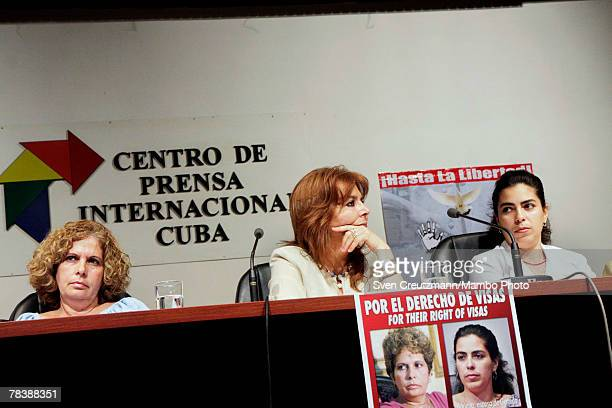 Olga Salanueva wife of the convicted Rene Gonzalez Comittee head Graciela Ramirez and Adriana Perez wife of the imprisoned Gerardo Hernandez attend a...