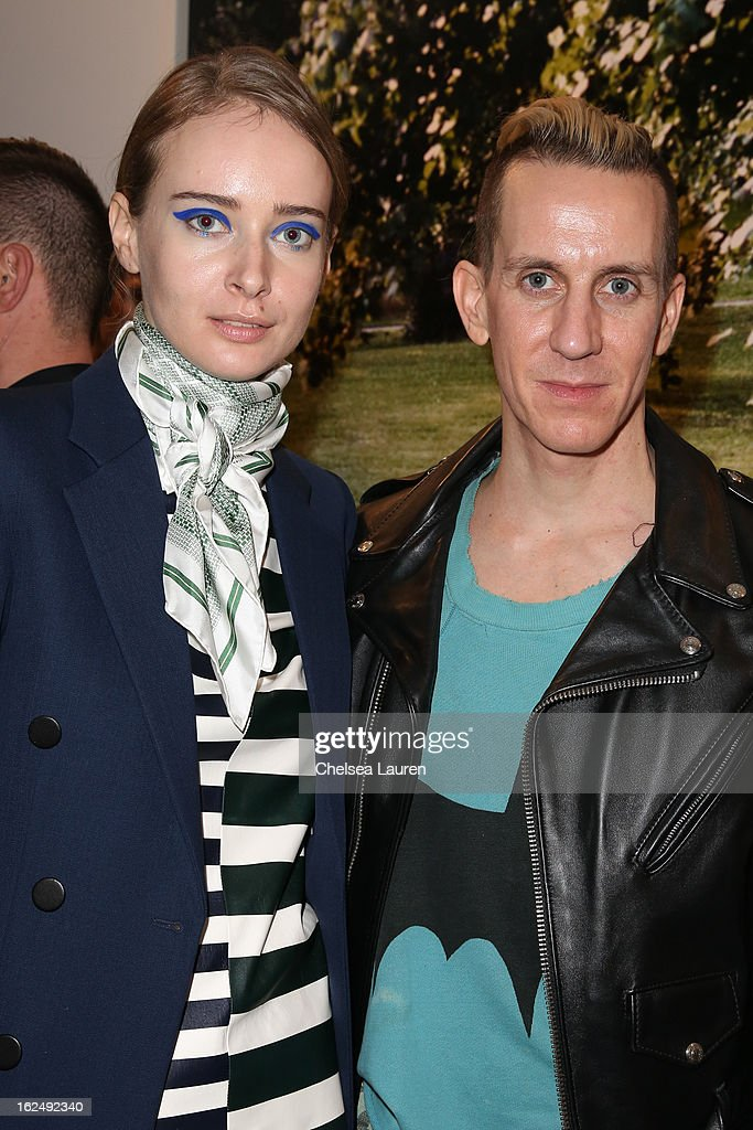 Olga Sorokina (L) and designer Jeremy Scott visit the Mario Testino opening at PRISM during Academy Awards week on February 23, 2013 in Los Angeles, California.