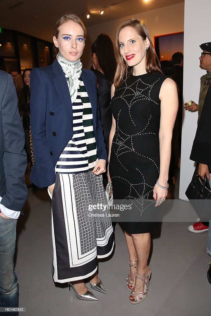 Olga Sorokina (L) and filmmaker / artist Liz Goldwyn visit the Mario Testino opening at PRISM during Academy Awards week on February 23, 2013 in Los Angeles, California.
