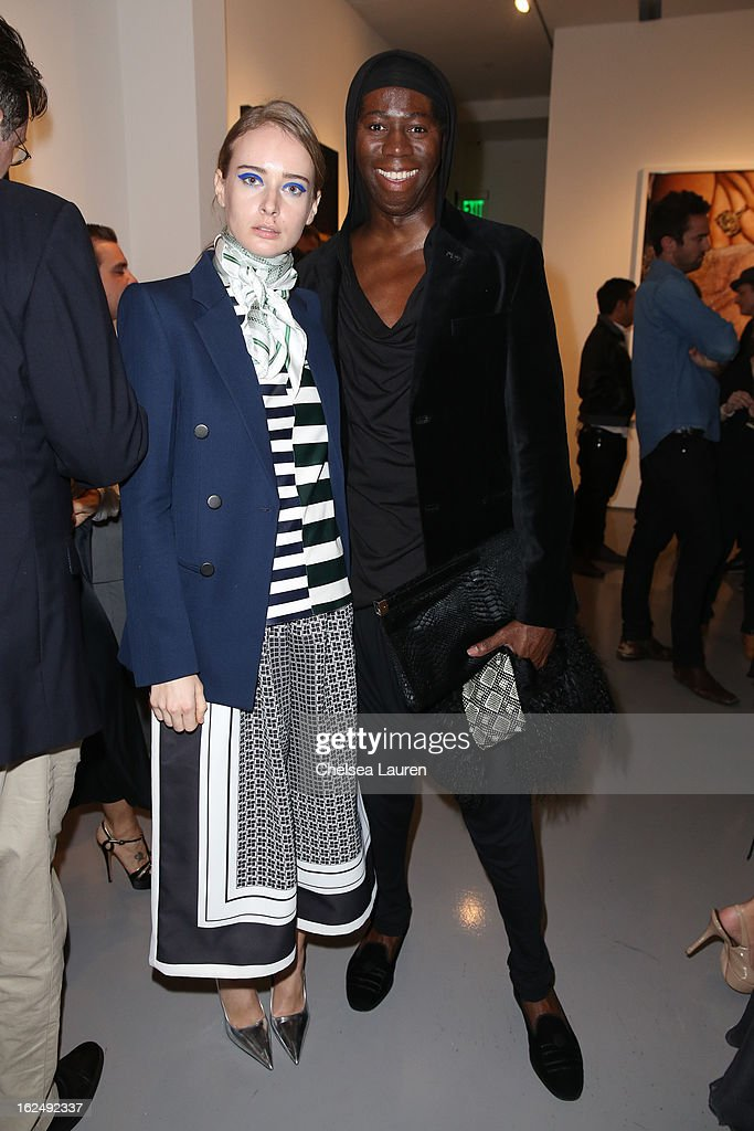 Olga Sorokina (L) and TV personality Miss J Alexander visit the Mario Testino opening at PRISM during Academy Awards week on February 23, 2013 in Los Angeles, California.