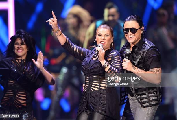 Olga Tanon and Elvis Crespo perform at Premios Tu Mundo Awards at American Airlines Arena on August 21 2014 in Miami Florida