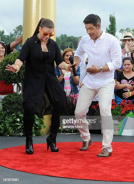 Olga Tanon and Johnny Lozada dance during Univision's morning show Despierta America 16th anniversary at Epcot Center Walt Disney World on May 3 2013...