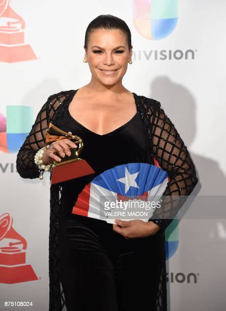 Olga Tanon poses with the trophy for Best Tropical Fusion Album during the 18th Annual Latin Grammy Awards in Las Vegas Nevada on November 16 2017 /...