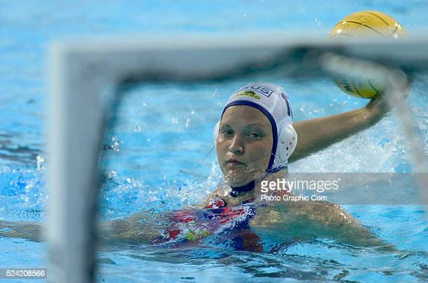 Olga Turova prepares to shoot the ball during the bronze medal match at the 2004 Fina Women's World League Water Polo Finals