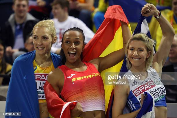 Olha Saladukha of Ukraine Ana Peleteiro of Spain and Paraskevi Papahristou of Greece celebrate winning medals during the final of the women's triple...