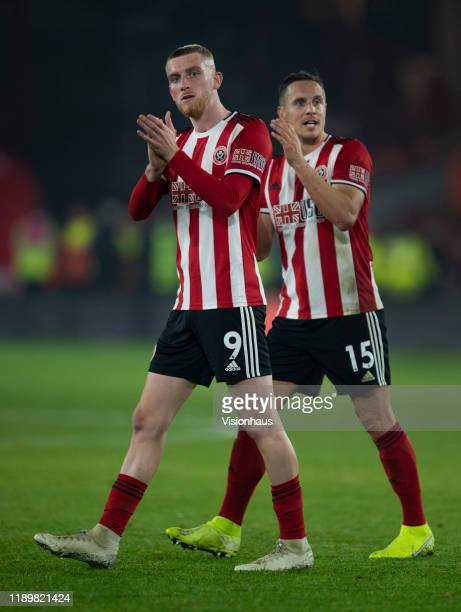 Oli McBurnie and Phil Jagielka of Sheffield United applaud the fans after during the Premier League match between Sheffield United and Manchester...