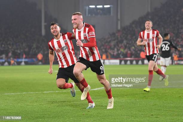 Oli McBurnie of Sheffield United celebrates after scoring his sides third goal during the Premier League match between Sheffield United and...