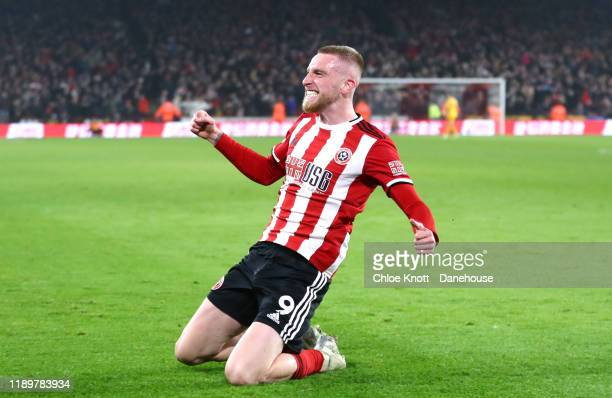 Oli McBurnie of Sheffield United celebrates scoring his teams third goal during the Premier League match between Sheffield United and Manchester...