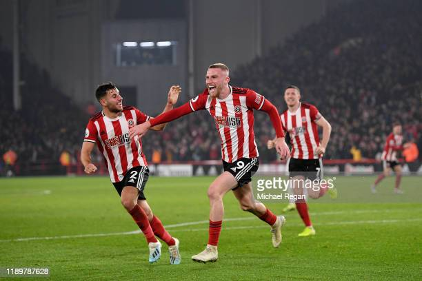 Oli McBurnie of Sheffield United celebrates scoring to make it 3-3 during the Premier League match between Sheffield United and Manchester United at...