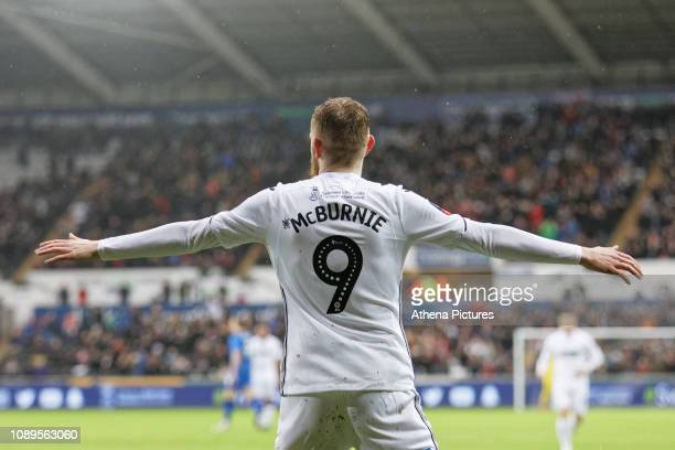 Oli McBurnie of Swansea City celebrates his opening goal during the FA Cup Fourth Round match between Swansea City and Gillingham at the Liberty...