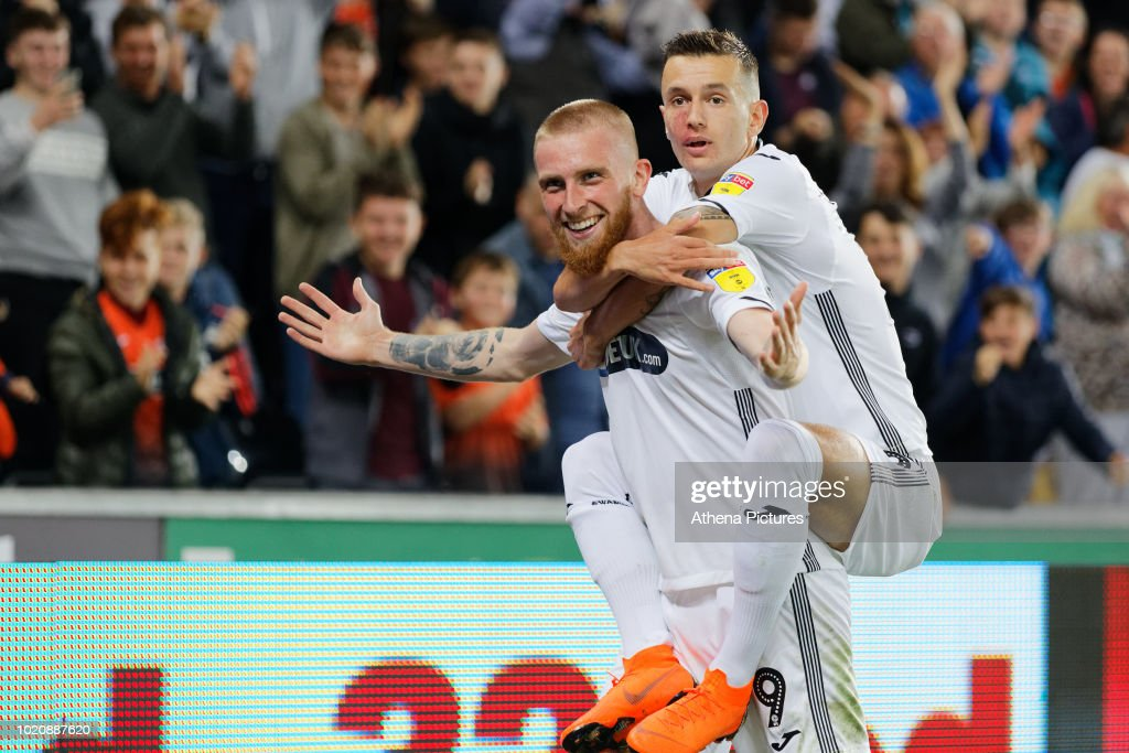 Oli McBurnie of Swansea City celebrates his second goal with team mate Bersant Celina during the Sky Bet Championship match between Swansea City and Leeds United at the Liberty Stadium on August 21, 2018 in Swansea, Wales.