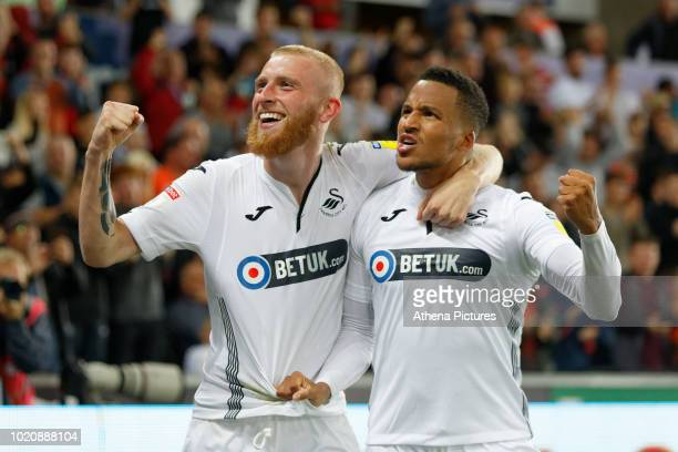 Oli McBurnie of Swansea City celebrates his second goal with team mate Martin Olsson during the Sky Bet Championship match between Swansea City and...