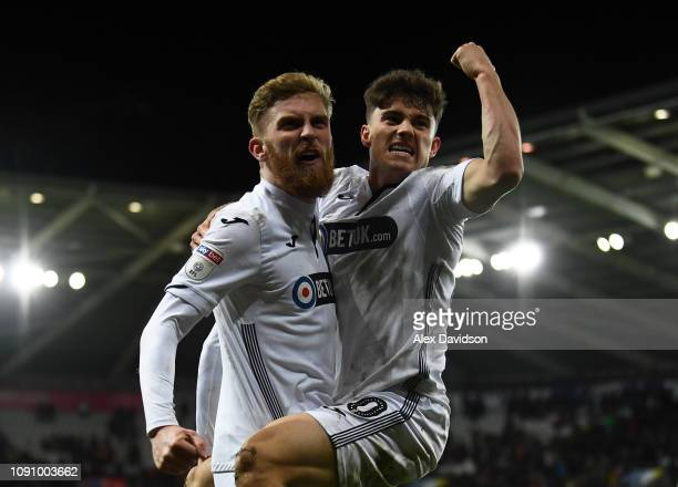 Oli McBurnie of Swansea City celebrates scoring his sides third goal with Daniel James of Swansea City during the Sky Bet Championship match between...