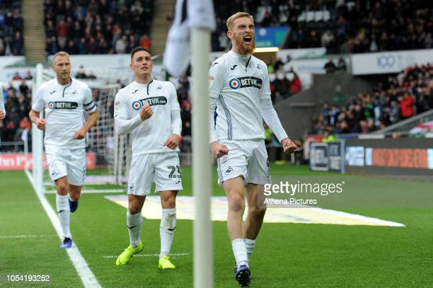 Oli McBurnie of Swansea City celebrates scoring the opening goal during the Sky Bet Championship match between Swansea City and Reading at the...