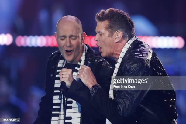 Oli P and David Hasselhoff perform during the TV show 'Heimlich Die grosse SchlagerUeberraschung' on March 17 2018 in Munich Germany