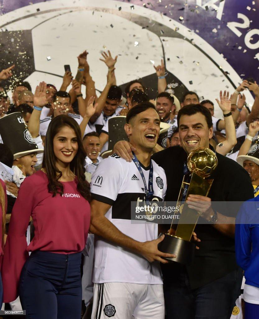 Olimpia\'s captain Roque Santa Cruz (C) and the President of Oliimpia ...