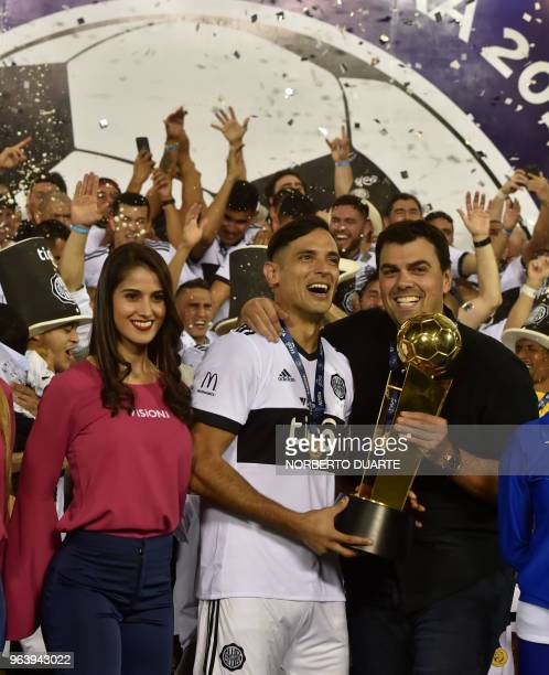 Olimpia's captain Roque Santa Cruz and the President of Oliimpia Marcos Trovato celebrate with the trophy after winning the Paraguayan apertura 2018...