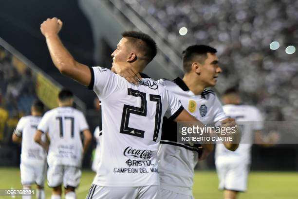 Olimpia's footballer Hugo Quintana celebrates after scoring against Guarani during their Clausura Tournament football match at the Defensores del...