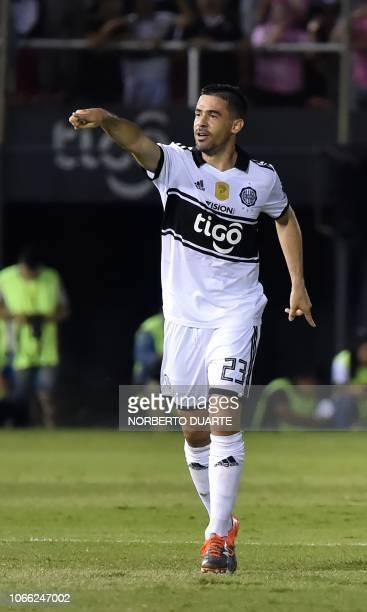 Olimpia's footballer Julian Benitez celebrates after scoring against Guarani during their Clausura Tournament football match at the Defensores del...
