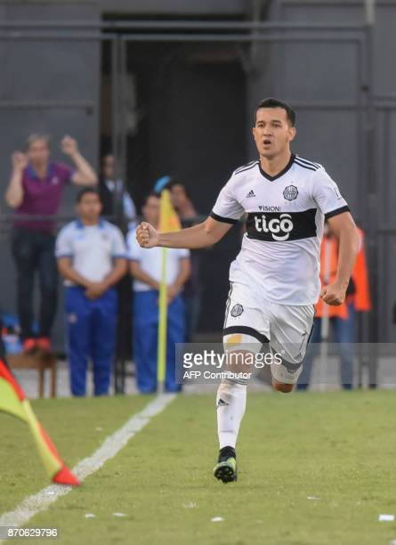 Olimpia's footballer Nestor Camacho celebrates after scoring against Cerro Porteno during the Paraguayan derby match in the 2017 Clausura tournament...