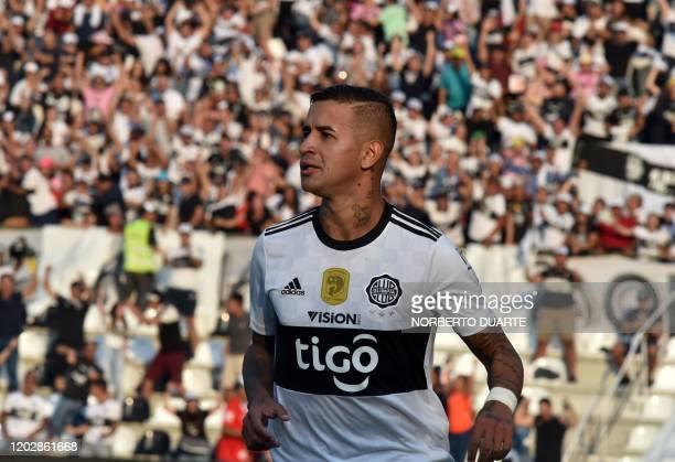 Olimpia's player Derlis Gonzalez celebrates after scoring against Cerro Porteno during a Paraguayan Apertura football tournament derby at the Manuel...