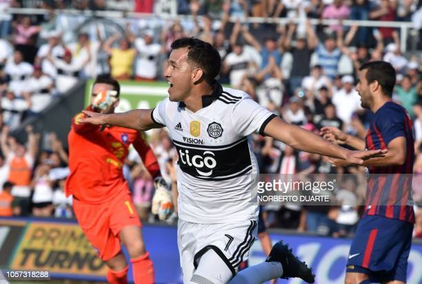 Olimpia's player Nestor Camacho celebrates after scoring against Cerro Porteno during the Paraguayan Clausura football tournament derby at the...