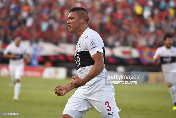 Olimpia's player Richard Ortiz celebrates after scoring against Cerro Porteno during their Paraguayan Clausura 2016 tournament football match at the...